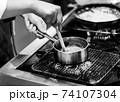 Chef cooking in a kitchen, chef at work, Black and White. 74107304