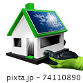 Gloved Hand Holding a Small Model House with Solar Panel on the Rooftop 74110890