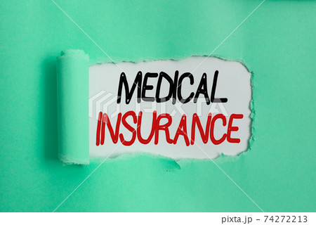 Writing note showing Medical Insurance. Business 74272213