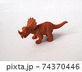 Triceratops dinosaur model made from brown rubber isolated on white background.   74370446