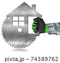 Carpenter Using Electric Circular Saw in the Shape of a Metal Model House 74389762