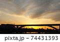 足立区と荒川区を繋ぐ扇大橋を渡る舎人線と富士山と荒川遊園地の観覧車の観える冬の夕暮れの風景  74431393