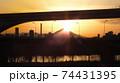 足立区と荒川区を繋ぐ扇大橋を渡る舎人線と富士山と荒川遊園地の観覧車の観える冬の夕暮れの風景  74431395