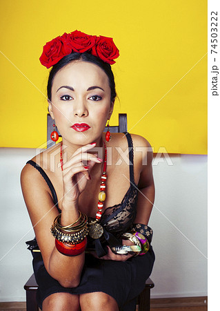 young pretty mexican woman smiling happy on yellow background, lifestyle people concept 74503222