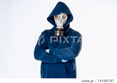 Portrait of a man in a gas mask. Panic during quarantine. Coronavirus pandemia 74599787