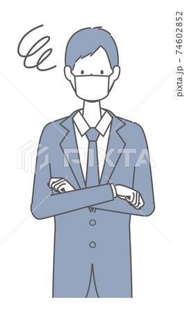 困っている マスクを着けたスーツの男性 74602852