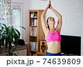 Young woman doing sports and yoga at home 74639809
