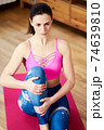 Young woman doing sports and yoga at home 74639810