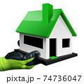 Hand with Protective Work Glove Holding a Small Model House 74736047