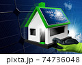 Hand with Work Glove Showing a Small Model House with Solar Panel on the Roof 74736048