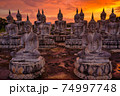 Many Statue buddha image at sunset in southen of Thailand 74997748