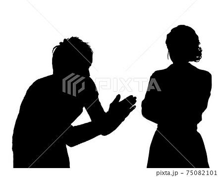 機嫌の悪い女性と謝る男性のシルエット 75082101