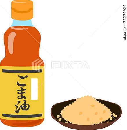 ビン入りのゴマ油と皿に盛ったゴマ 75276926