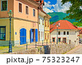 A street with old colorful houses in the small European historical town of Kamnik, Slovenia 75323247