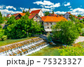 A small waterfall in the ancient Slovenian town Skofja Loka 75323327