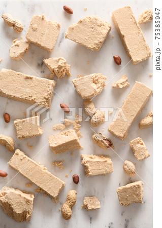 Sweet dessert halva prepared from sunflower seeds. 75385947