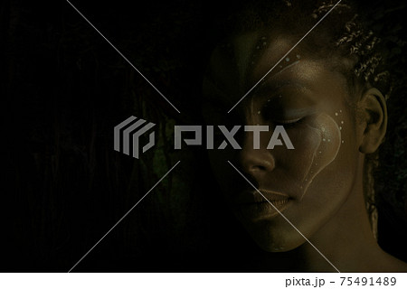 Art photo of Africal woman with tribal ethnic paintings on her face 75491489