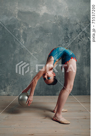 Young girl professional gymnast woman dance rhythmic gymnastics with ball at studio 75537200