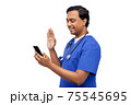 doctor or male nurse having video call on phone 75545695