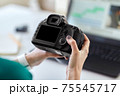 woman with camera and video editor on laptop 75545717