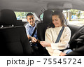 female car driver takes credit card from passenger 75545724