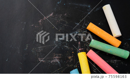 Colored chalk on a blackboard. Blackboard with crayons. The concept of school 75598163