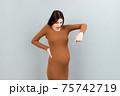 Young surprise or shocked woman pregnant isolated colored background. expression female 75742719