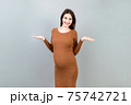 happy surprised pregnant woman posing isolated over colored background. copy space 75742721