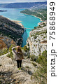 Woman View on Guadalest water reservoir with turquoise water in Alicante province Spain 75868949