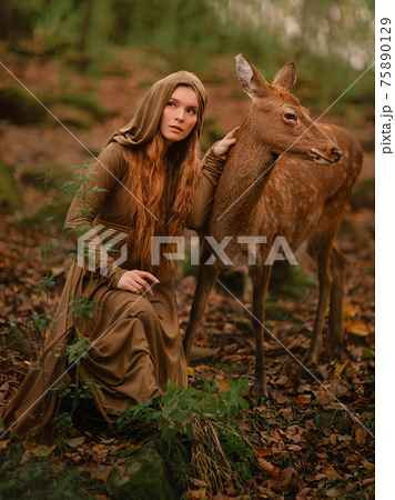 Redhead girl with deer in a long dress 75890129