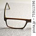 Eyeglasses on paper with lorem ipsum 75911396