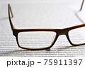 Eyeglasses on paper with lorem ipsum 75911397