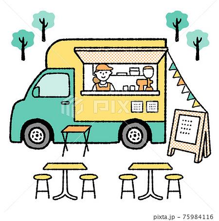 屋外のキッチンカーの中から笑顔でこちらを見ているユニフォーム姿の女性スタッフ テーブルと椅子と看板 75984116