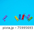Wooden violet clothespin with fracture leg on blue background 75995693
