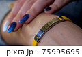Female hand with vaccined bracelet or label after injection 75995695