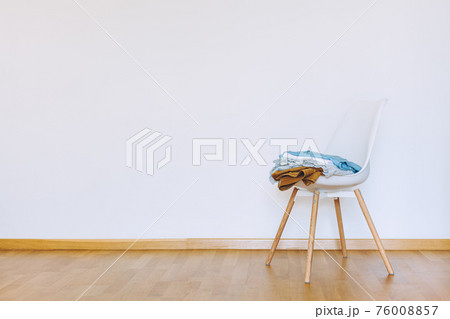 Indoors flat wall mockup with Clothes on Chair 76008857