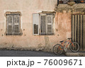 Old idyllic house with orange bike in front of it in a city in the Provence in France 76009671