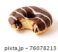Chocolate donut with missing bite on white background 76078213