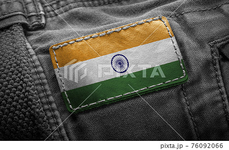 Tag on dark clothing in the form of the flag of the India 76092066