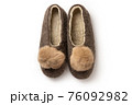 Felt slippers on white background in closeup 76092982