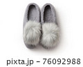 Felt slippers on white background in closeup 76092988