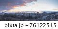 Minsk roofs of houses at sunset 76122515
