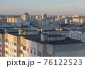 Minsk roofs of houses at sunset 76122523