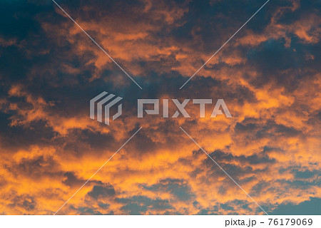 Beautiful sky landscape with yellow clouds at sunset 76179069
