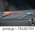 Repairing dents in a car 76182705