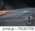 Repairing dents in a car 76182706