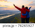 Senior healthy couple hiked the hill to see the sunrise view over Mekong river at Phu Pha Dak hill in Nong Khai, Thailand 76265927