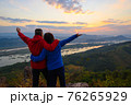 Senior healthy couple hiked the hill to see the sunrise view over Mekong river at Phu Pha Dak hill in Nong Khai, Thailand 76265929