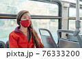 Bus travel during coronavirus. Asian woman commuter wearing mask riding public transport commuting as prevention. Safety in city outdoor indoor people lifestyle. 76333200