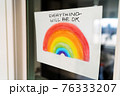 Coronavirus Rainbow campaign painting hanging at home window to spread positivity with message EVERYTHING WILL BE OK in english. UK, USA, Australia. 76333207
